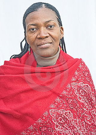 African woman in red patterned shawl.
