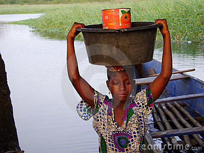 African woman at the river Editorial Stock Photo