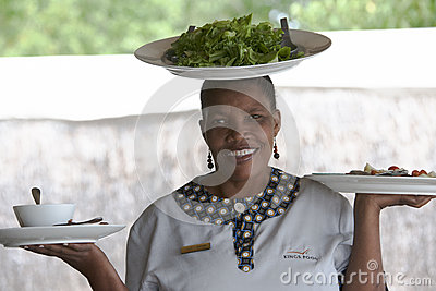 African woman serving salat on the head Editorial Photography