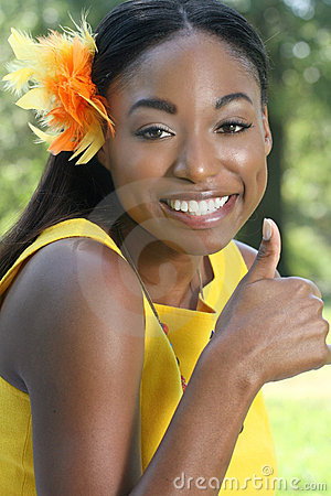 African Woman: Smiling, Thumbs Up