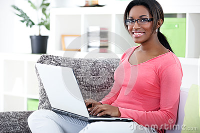 African woman using laptop