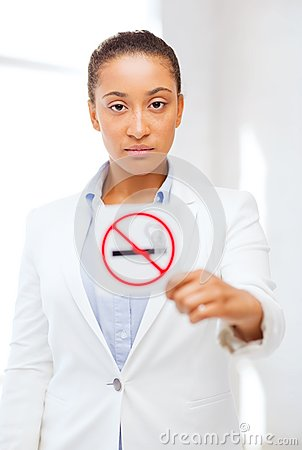 Free African Woman With Restriction No Smoking Sign Royalty Free Stock Photography - 34392077