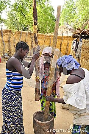 AFRICAN women at work preparing food Editorial Image