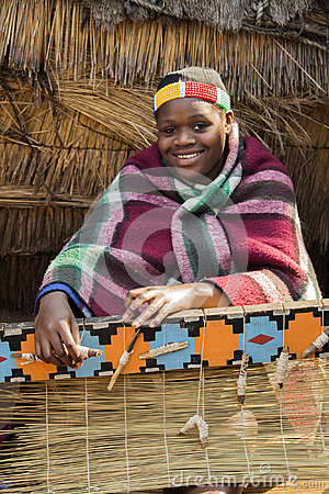 African Zulu Woman Weaves Straw Carpet Editorial Image