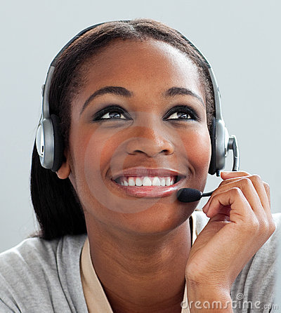 Afro-American businesswoman using headset