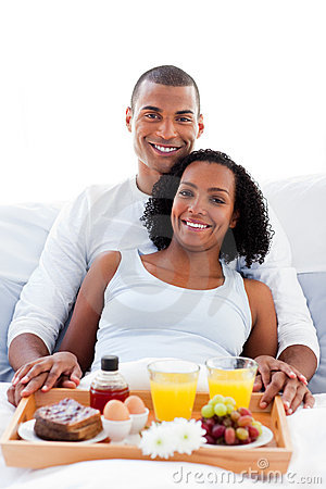 Afro-american couple having breakfast