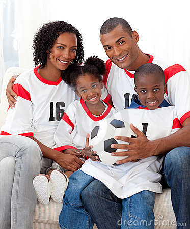 Afro-american family holding a soccer ball