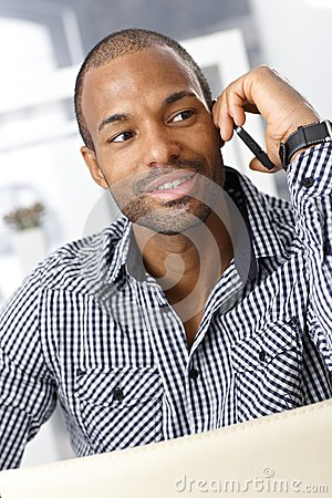 Afro-American guy speaking on cellphone