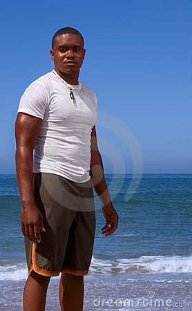 Afro American man on beach, stand by sea