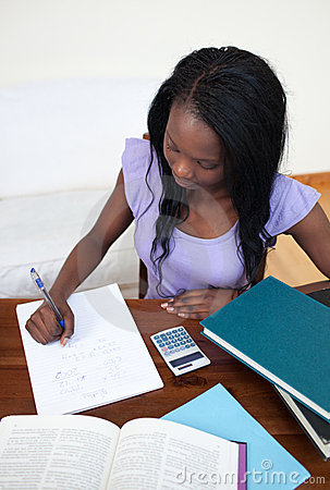 Afro-American teen girl doing her homework