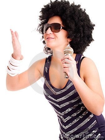 Afro singer holding microphone