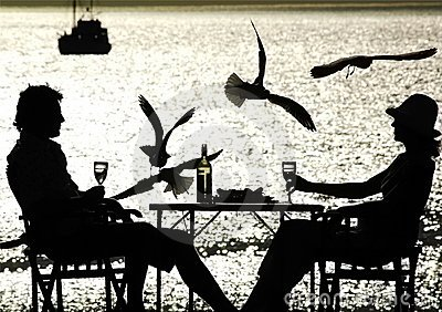 Couple having a meal by the sea