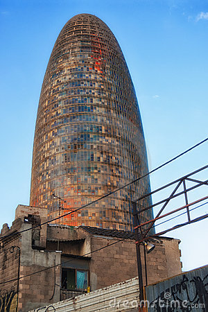 Agbar tower behind a shanty town in Barcelona
