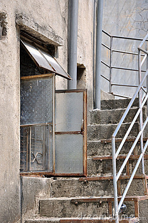 Aged architecture with window and stair