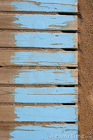 Aged beach blue wooden floor on sand