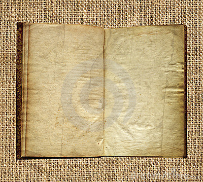 Aged book on burlap background