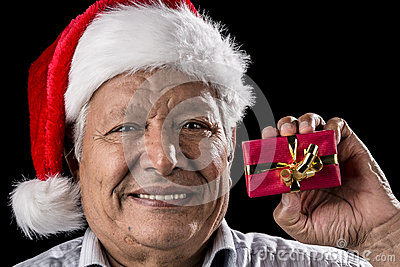 Aged Gentleman with Red Cap Holding Small Gift