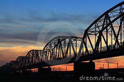 Aged and old railroad bridge silhouette