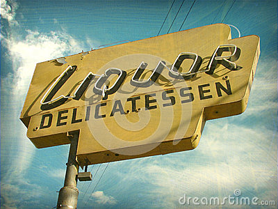 Aged vintage liquor store sign