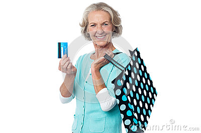 Aged woman displaying her cash card
