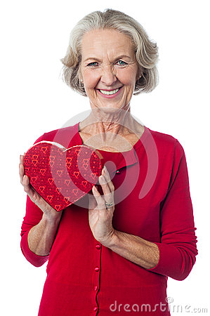 Aged woman holding a red valentine gift box