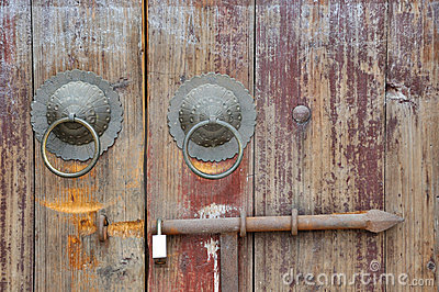 Aged wooden door of Chinese traditional style
