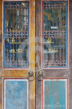 Aged wooden door with grid