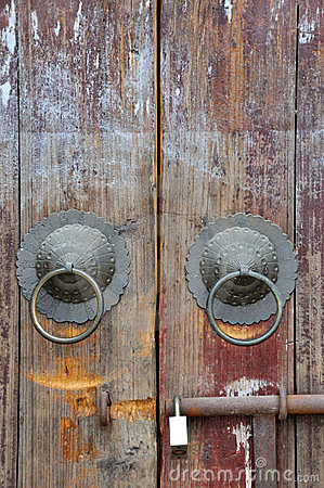 Aged wooden door with knocker and lock