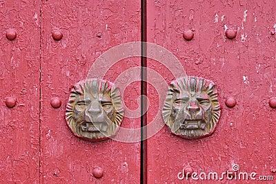 Aged wooden door in red