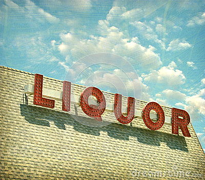 Aged and worn vintage liquor store sign