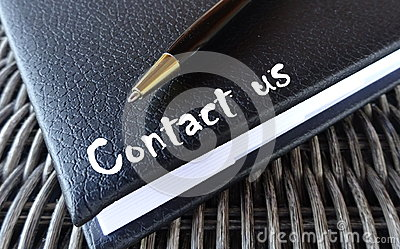 Contact us concept with agenda and pen. Stock Photo