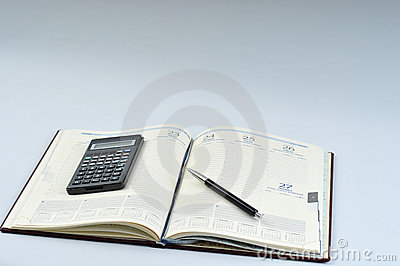 Agenda, pen and calculator