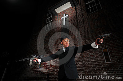 Agent/ Killer pointing guns towards target
