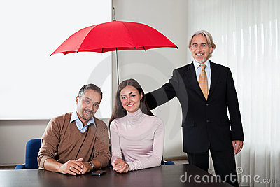 Agent providing insurance cover to a young couple