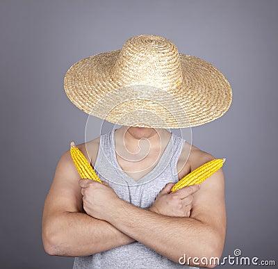 Aggressive farmer show two corns.