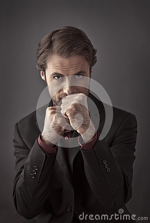 Aggressive forty years old businessman in a boxing stance