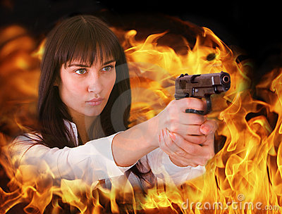 Aggressive girl shoots from flame.