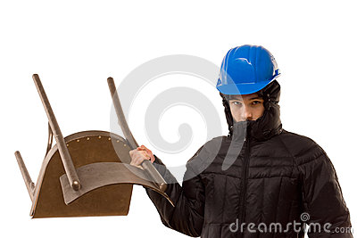 Aggressive hooligan wielding a wooden chair