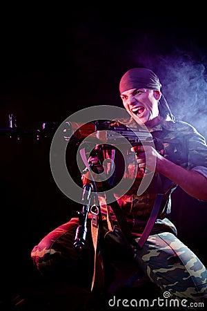 Aggressive soldier shooting his enemies