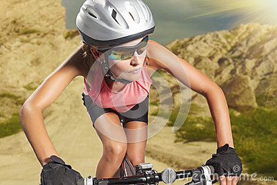 Aggressive young female biker rides a mountain bike. athlete equ