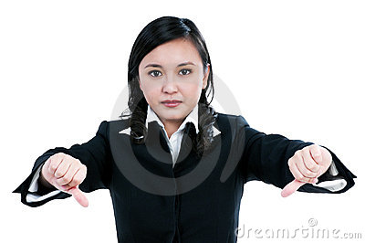 Agitated businesswoman showing thumbs down sign