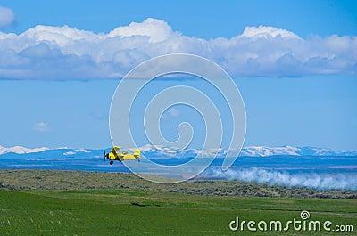 Agricultural aircraft spraying fertilizer