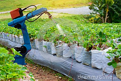 Agricultural machinery robots mechanical arm working technology. Stock Photo