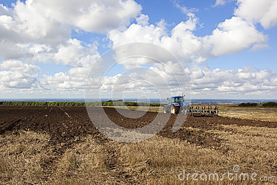 Agricultural scene with tractor