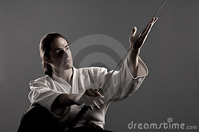 Aikido man looking at katana(sword)
