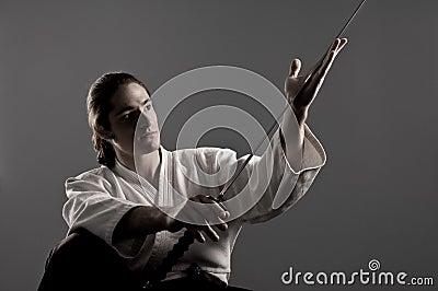 Aikido man looking at katana(sword)