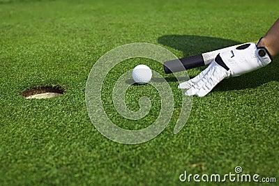 Aiming golf ball to a hole like billiard