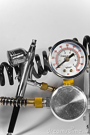Air brush with pressure gauge and pipes.