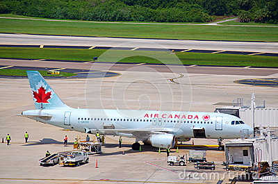 Air Canada plane with busy grounds crew Editorial Photo