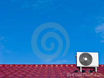 Air conditioner compressor on the red roof